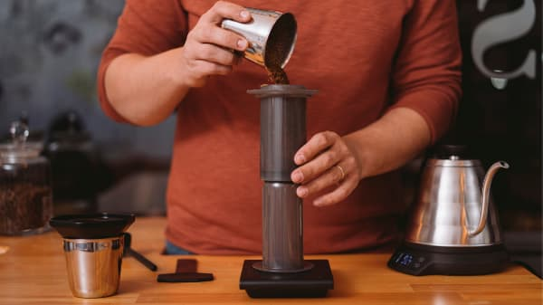 Adding Ground Coffee To AeroPress