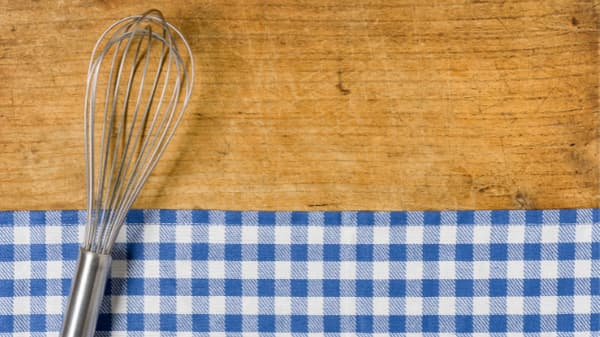 whisk on a wooden table